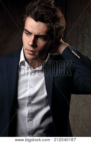 Confident Thinking Business Man With Anxious Look In Blue Fashion Suit And White Style Shirt On Dark