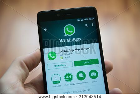 Los Angeles, november 2, 2017: Man hand holding smartphone with Whatsapp application in google play store