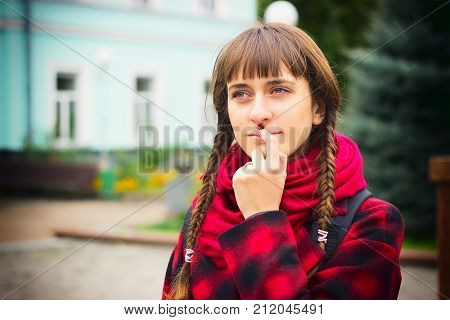 Attractive Teenage Girl Deliberates A Decision