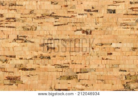 Cork sheet surface with parallel layers, comprised of multilayered cork oak, Quercus suber. Decorative panels and veneers, used as bulletin boards, floor and wall tiles. Top view. Macro photo.