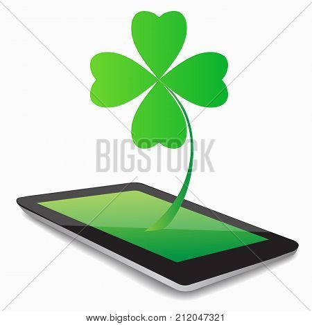 Four- leaf clover - Irish shamrock St Patrick s Day symbol. Green glass clover on white background.Stylish abstract St. Patrick s day leaf clover whit tablet computer.