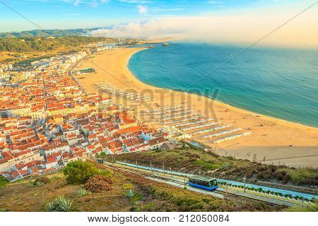 View of Nazare cabins train Funicular. Nazare in Portugal is the most popular seaside resorts in Atlantic coast. Nazare Skyline and beach waterfront from Nazare Sitio.