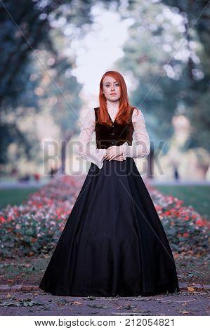 Portrait of redhead woman in Victorian dress