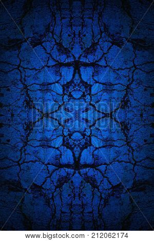 Dark blue mirror image old cracked wall background with spotlight