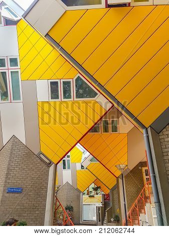 ROTTERDAM HOLLAND - AUGUST 21 2017; Cube houses are a set of bright yellow angled cube adjoining innovative architecturally styled apartments built in Rotterdam