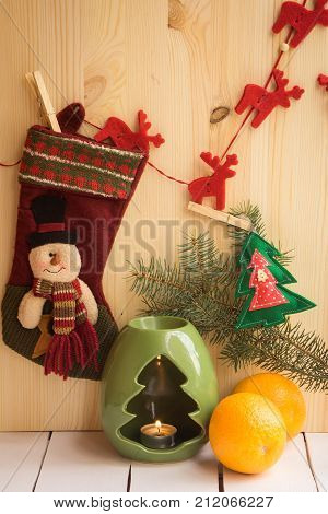 Christmas table place setting with dinner plates, napkin, cutlery, fir with xmas decoration on wooden background