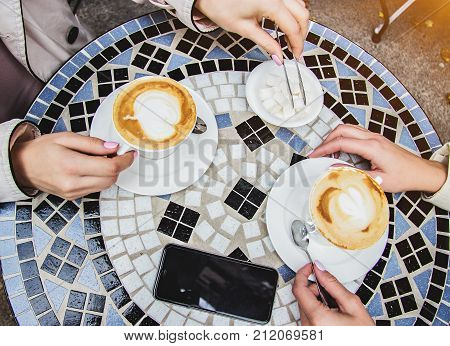 Top View Women Having Coffee Brake In French Cafe.
