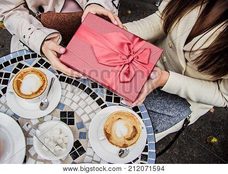 Happy Birthday. Women Holding Gift Box.