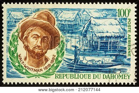 Moscow Russia - November 02 2017: A stamp printed in Dahomey shows portrait of American poet Walt Whitman (1819-1892) circa 1970