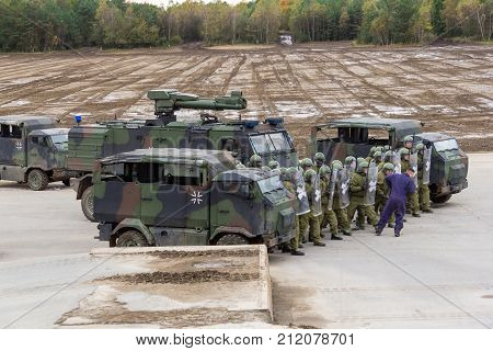 MUNSTER / GERMANY - OCTOBER 9 2017: german military police soldiers defends an area against role playing demonstrators