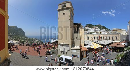 CAPRI ITALY - JUNE 26 2014: Clock Tower in Capri on JUNE 26 2014. Main square La Piazzetta in Capri Italy.