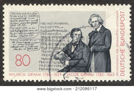 MOSCOW RUSSIA - CIRCA OCTOBER 2017: a post stamp printed in GERMANY shows Grimm Brothers dedicated to Birth Bicentenaries of Grimm Brothers circa 1985