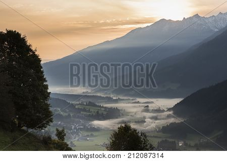The valley of the Salzach in the morning mist during sunsrise in Salzburger Land in Austria.