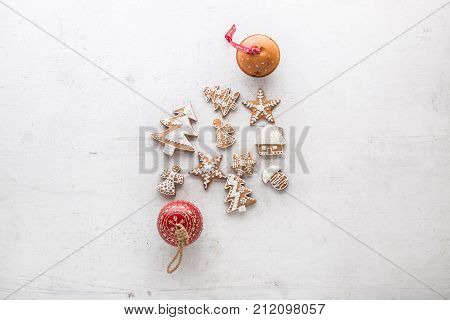 Top Of View Christmas Gingerbread And Jingle Bells On White Concrete Background