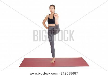 young asian woman doing yoga in Hasta Padangusthasana or Standing Hand to Toe yoga pose on the mat isolated on white background exercise fitness sport training and healthy lifestyle concept