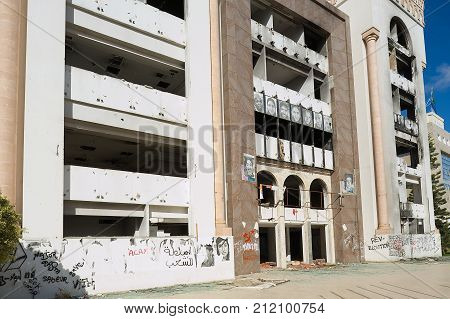 SFAX, TUNISIA - NOVEMBER 30, 2011: Exterior of the Democratic Constitutional Rally party building ruined during the Arab spring in Sfax, Tunisia.