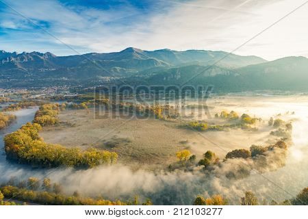 The Eden valley - View of the Adda river during a foggy morning Airuno Italy