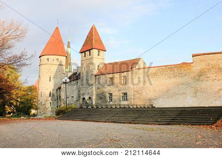 Tallinn City Wall Historic Stone Structure in Old Town Tallinn, Estonia. Medieval architecture, build to protect city from intruders, currently a popular tourist landmark. Street view with copyspace.