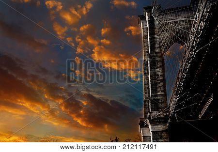 Stars and stripes flying on Brooklyn Bridge Brooklyn Bridge New York City business water brooklyn skyline