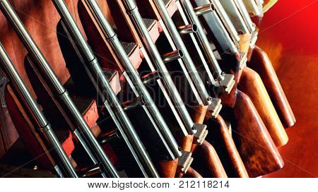 Group of old vintage guns for playing shooting games or carnival game. Rifle weapon toy guns game for background.