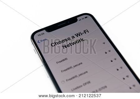 PARIS FRANCE - NOV 3 2017: New Apple iPhone X 10 smartphone first run with Choose a Wi-Fi network message