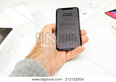 PARIS FRANCE - NOV 3 2017: New Apple iPhone X 10 smartphone first run with hand accepting Terms and Conditions of Privacy and warranty