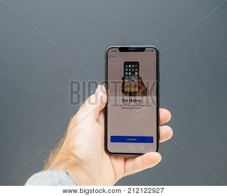 PARIS FRANCE - NOV 3 2017: New Apple iPhone X 10 smartphone first run with hand accepting Go Home message
