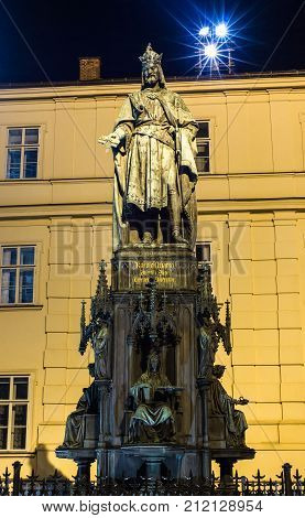 Prague, Czech Republic - October 10, 2017: Evening view on statue of Charles IV near the Charles Bridge Prague, Czech Republic. Neo-Gothic bronze statue of Charles IV was unveiled  in 1848.