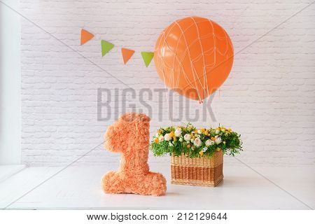 decor for the holiday birthday. one years. balloon and a large figure. for smash the cake