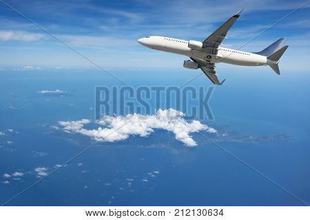 Airplane flying away in to sky high altitude above the white clouds, Airplane taking off, Travel by air transport