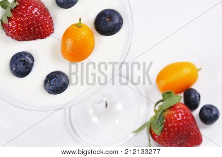 Various fruit and yoghurt on a table