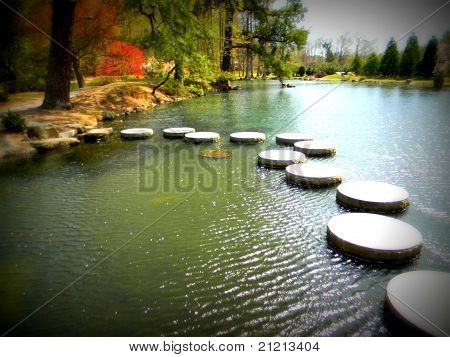 Body of water with stepping stones in Japanese Garden poster