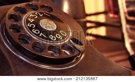 Closeup Of Black Retro Vintage Telephone With Rotary Dialer Or Dialpad. Local Vintage Telephone For
