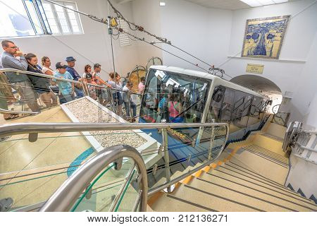 Nazare, Portugal - August 15, 2017: People waiting to take Nazare Funicular from Sitio descending to Praia. Internal access to the funicular. Prospective view.