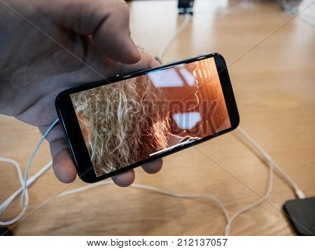 STRASBOURG FRANCE - NOV 3 2017: Customer trying the latest OLED display on the iphone X wathcning iTunes movies
