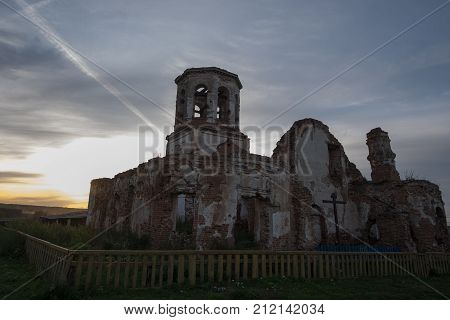 A very old ruined Church of the fifteenth century in the light of the sunset