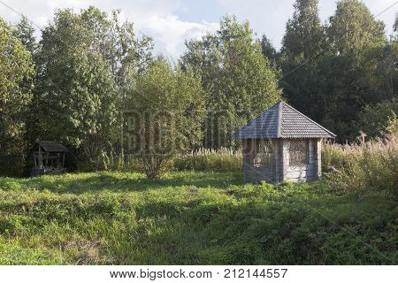 Equipped source and gazebo beside the road to the village Gorodischna, Nyuksensky District, Vologda Region, Russia