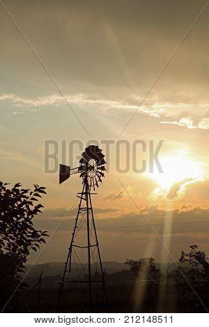 South African silouette of a windpump at sundown.