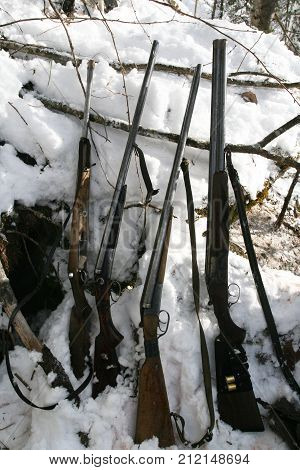 Hunting weapons Siberian hunters in the winter the den of a bear. Shotgun and rifle on the winter hunt in Siberia. Russia