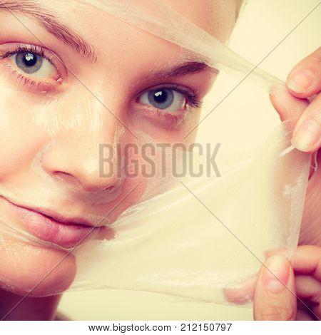 Woman Removing Facial Peel Off Mask Closeup
