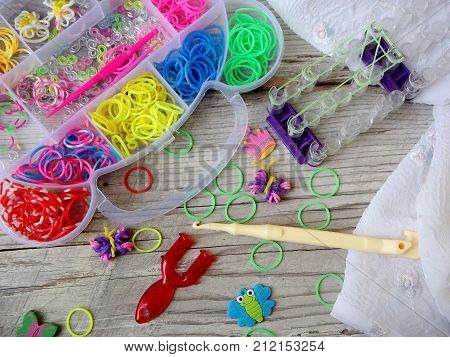 Colorful Of Elastic Rainbow Loom Bands Kit On Wooden Background