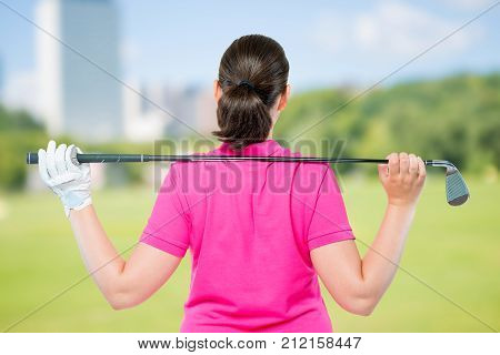 Back Is Athletes With Equipment For Playing Golf On A Background Of Golf Courses