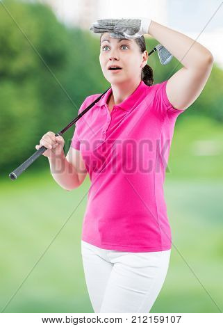 Surprised Woman Golfer Looking Where The Ball Flew Away On A Background Of Golf Courses