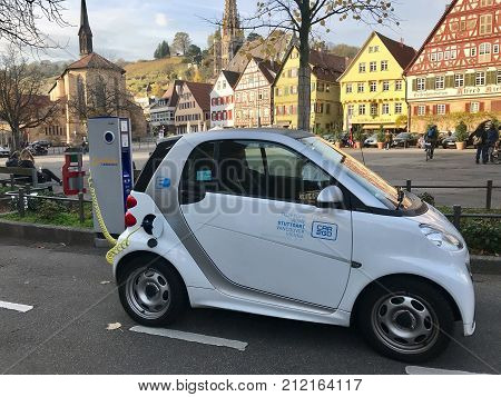 Esslingen, Germany - November 4, 2017: An electronic Smart is charging in Esslingen in front of the beautiful old houses of this ancient city in Germany.