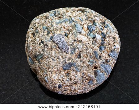 Pebble Of Arkose Sandstone On Dark Background