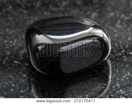 Polished Black Onyx Gemstone On Dark