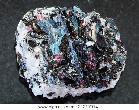 Rough Gneiss Stone With Crystals On Dark