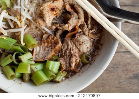 stewed pork nooddle soup Noodle soup thai style put blood in the soup hot for mellow soup (Pork or Beef) on wooden table poster