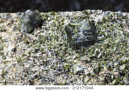 Crystals Of Epidote On Rock Close Up