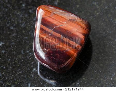 Tumbled Bull's Eye Gemstone On Dark Background